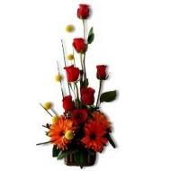Arreglo navide�o de rosas y gerberas