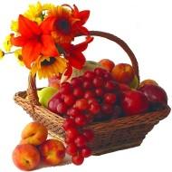 Cesta de frutas con lirios y girasoles